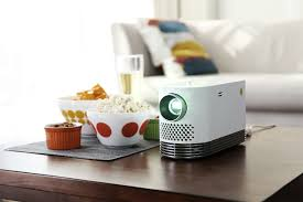 laser home theater projector lg u0027s compact probeam laser projector lets you hold 2 000 lumens in