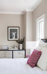 dark stained cabinet with cream cabinet doors transitional bedroom