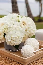 White Hydrangea Centerpiece by A Beautiful Lantern Centerpiece Surrounded By White Hydrangeas And