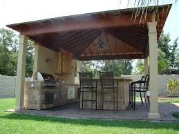 backyard grilling station brick metal awning patio deck design