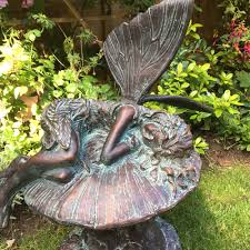 garden sculptures garden fairies to buy candle and blue