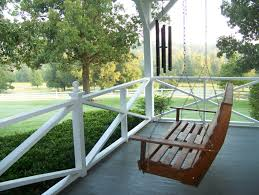 cool wooden porch swing chair white stained wood fence for patio