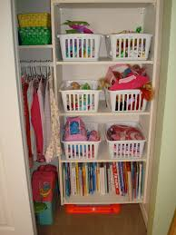 space organizers floating white wooden closet with shelves for books and toys