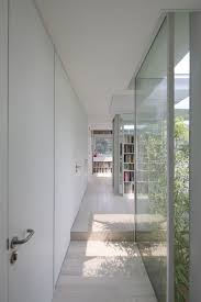 eco friendly house white door in amazing minimalist library room