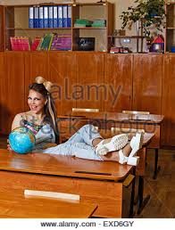 Feet On The Desk Tearaway Is Sitting With Her Feet On The Desk Leaning On A Globe
