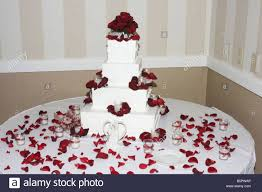 fancy wedding cakes a fancy wedding cake with roses on top and candles burning