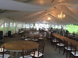 tent draping wedding tent with chandeliers and sheer draping in illinois