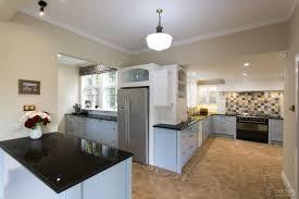 multi space kitchen by mastercraft kitchens with mosaic splashback