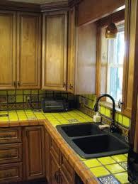 How To Design Kitchen Cabinets by Mediterranean Kitchen With Blue Cabinets Black Appliances White