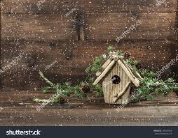 christmas tree decoration birdhouse over rustic stock photo