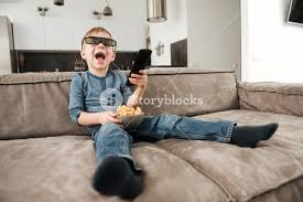 Sofa Control Photo Of Little Boy Sitting On Sofa Holding Remote Control While