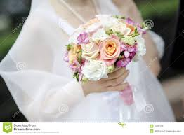 wedding flowers images free holding beautiful wedding flowers bouquet stock photo