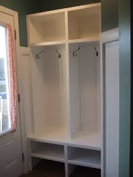 very small wood mudroom cubby design painted with white color with