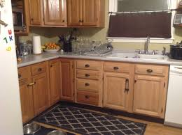 how to lighten dark cabinets without painting dated oak cabinets once again