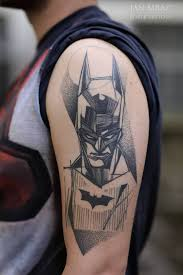 black ink abstract batman tattoo on man left half sleeve