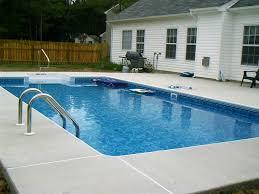 concrete decking around pool round designs