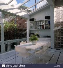 white table and chairs in modern white dining room extension with