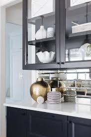 beveled glass kitchen cabinets beveled mirror subway tiles with black cabinets