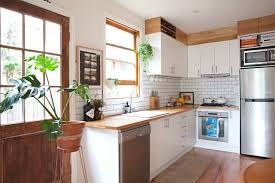 how do you fill the gap between kitchen cabinets and ceiling kitchen cabinet soffit space ideas apartment therapy