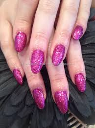 almond shaped acrylic nails with fairy godmother pink glitter