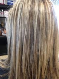shades of high lights and low lights on layered shaggy medium length this beautiful hair color was created by foiling the top of head in