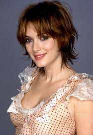 how to style razor haircuts edgy razor cut with highlights winona ryder s layered short bob