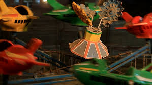 a colourful indian flying plane carousel at a funfair a carousel