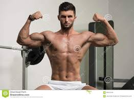 arabic man showing his well trained biceps stock photo image