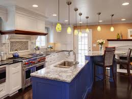 chalk blue color painted kitchen island with marble countertop