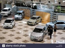 toyota automobiles potential buyers look over the latest model toyota automobiles on