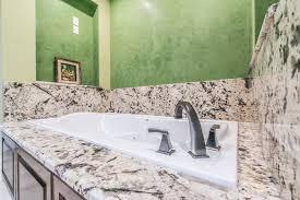 delicatus white granite bathroom countertops in charleston sc