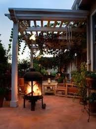 How To Decorate A Patio Deck Decorating Ideas Pergola Lights And Cement Planters Deck