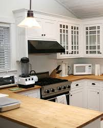 Kitchen With Wood Countertops And White Cabinets - White kitchen cabinets with butcher block countertops