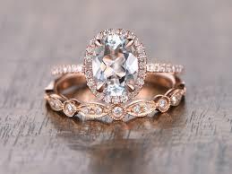 deco wedding band oval cut aquamarine diamond pave halo engagement ring matching