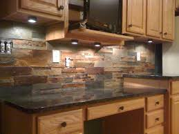 kitchen this natural slate tile backsplash is shown with uba tuba