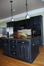 Rustic Painted Kitchen Cabinets by I Love The Red Island With The Black Cabinets I Believe I U0027m Going