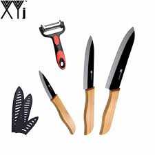 design chef promotion shop for promotional design chef on new design bamboo handle black blade ceramic knife 3 inch 5 inch 6 inch best kitchen knife multifunctional peeler xyj brand