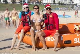 Australian celebrate Christmas on the beach as heatwave sweeps