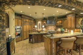luxury kitchen with stone archway and granite counter tops