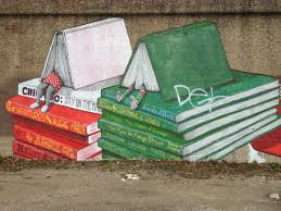 covered by books a mural at pilsen neighborhood chicago credit the mural was painted in chicago on a lengthy old wall in pilsen neighborhood