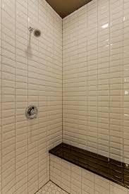 photos hgtv white subway tile shower with black bench arafen photos hgtv white subway tile shower with black bench