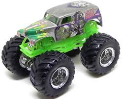 original grave digger monster truck wheels monster jam grave digger silver 1 64 monster truck ebay