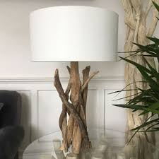 driftwood sphere floor lamp designed by by karen miller devon