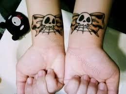 emo skull bow tattoo tattoo ideas pickers