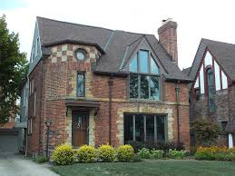bath brick tudor style home sits meticulously landscaped house