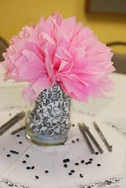 tissue paper centerpieces like the letter on the table wedding