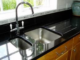 stone vessel sink in impala black granite with waterfall faucet