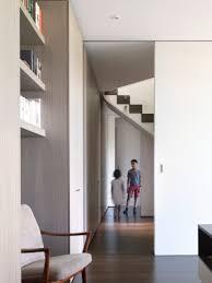 cliff top house luigi rosselli architects pale wood grain textured wardrobe
