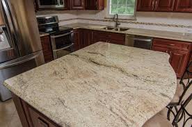 granite countertops for ivory cabinets golden ivory granite with cherry cabinets traditional kitchen