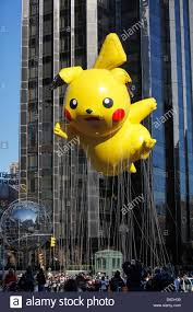 pikachu pokeman balloon into columbus circle duirng macy s